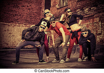street culture - Group of young modern people posing...