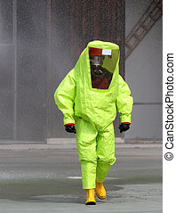 yellow radiation suit and infectious diseases - man with...