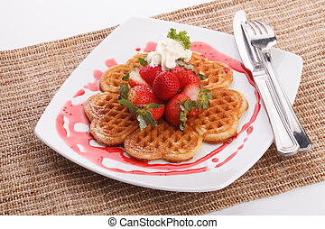 waffle topping with strawberry and decoration with...