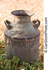 Antique Milk Can on farm - Horizontal Photo of an Antique...