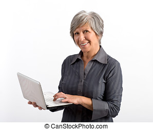 Smiling Modern Adult Woman Using Laptop - Smiling Modern...