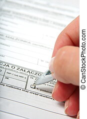 Filling in official form with pen