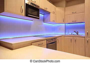 Modern luxury kitchen with purple LED lighting
