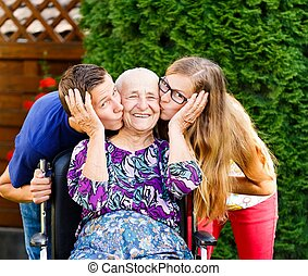 Lovely Grandmother - Contented grandmother being loved and...