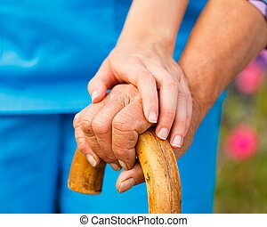 Supporting the Elderly - Supporting hand from doctor for...