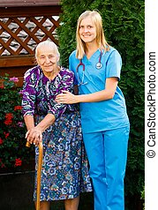 On a Walk in the Garden - Elderly patient and doctor on a...