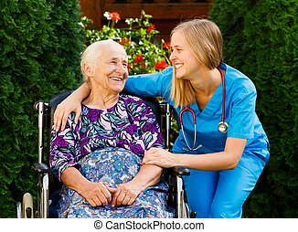 Elderly Home Care - Supporting young doctor with elderly...