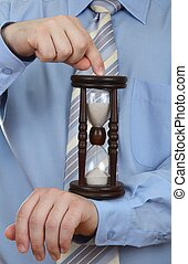 Businessman with hourglass - as quot;deadlinequot; -...