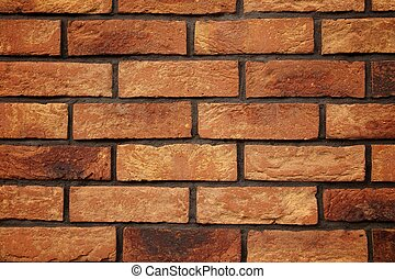A brick old wall made of red and yellow bricks