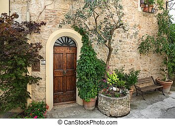 Old door in a Tuscany town, Italy - Front door of a...