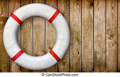 Lifebuoy on a wooden wall - White lifebuoy on a wooden wall