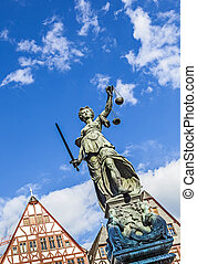 Justitia Lady Justice sculpture on the Roemerberg square in...