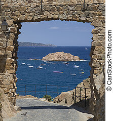 Gate on the sea - View of the Mediterranean sea from a...