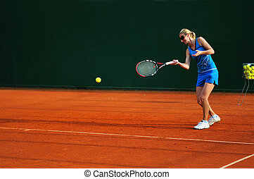 tennis woman - woman practicing tennis sport outdoor