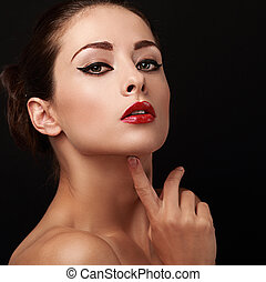 Beautiful sexy woman make up with bright red lips on black...