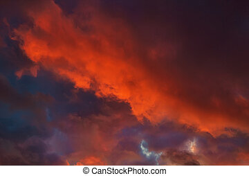 Dark cloudy dramatic sky in sunset