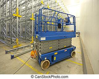 Scissor lift aerial work platform in warehouse