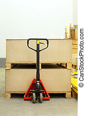 Pallet jack with big wooden crates boxes