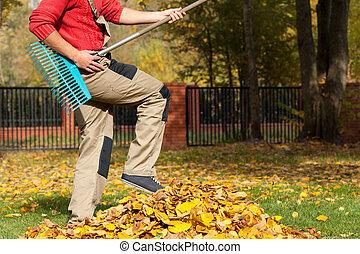 Gardener having fun during autumnal time