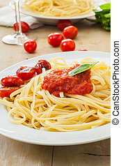 Italian food - Two plates of spaghetti with tomato and basil