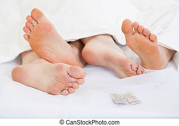 Feet of happy couple - Close up of feet of a happy couple in...