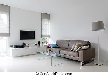 White living room with taupe sofa - White living room with...