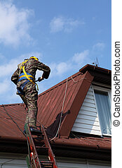 Construction worker on a roof