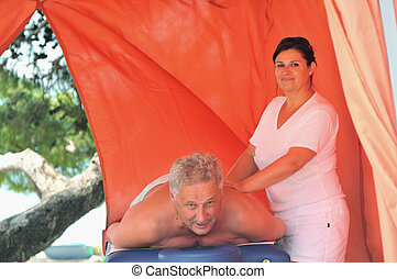 senior man have massage and spa therapy outside