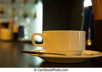 Close up Cup of Coffee on Wooden Table