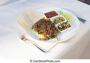 Grilled Steak Fajitas with Fixings on Plate at Place Setting