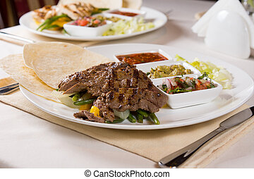 Grilled Steak Fajitas with Fixings on Plate at Place Setting...