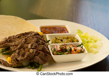 Grilled Steak Fajitas with Fixings on Plate - Close Up of...