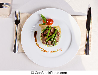 Gourmet Garnished Meaty Main Dish on Plate - Gourmet...
