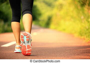 young fitness woman legs running at