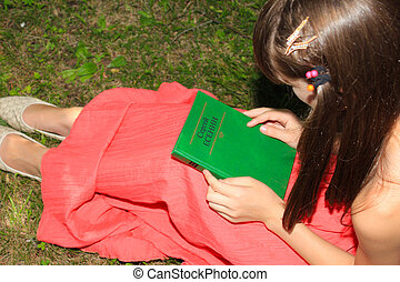 Girl in a red dress holding a book in her arms Sergei...