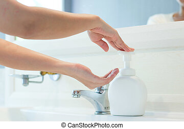 Hands applying sanitizer soap for killing a Bacterium