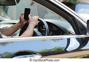 Driving and celphone - Man using celphone while driving the...