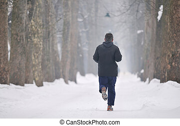 one older man running at alley on winter seasson at early...