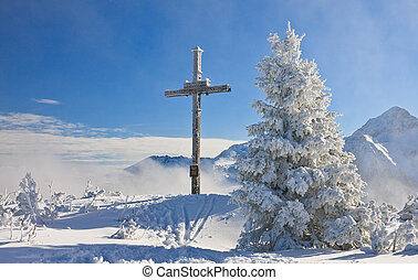 Worship the cross on the mountain Schladming Austria