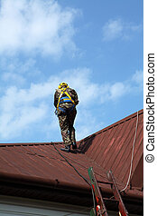 Construction worker wearing safety harness and line
