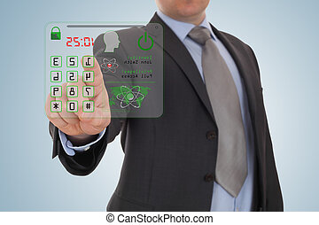 Businessman pressing the security code