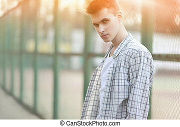 Fashion portrait handsome man in summer sunny day, deep look, st