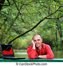 young businessman outdoor working on laptop