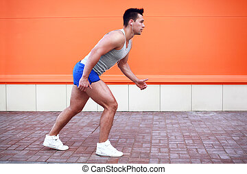 Fitness, sport, lifestyle concept - man running in the city
