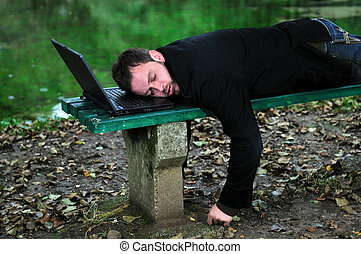 sleeping businessman outdoor - young businessman sleeping...