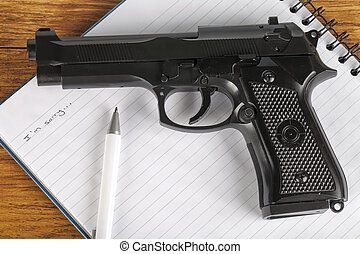 Concept of suicide note with gun
