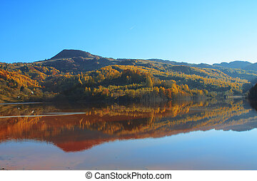 Autumn in the reflective water in Transylvania