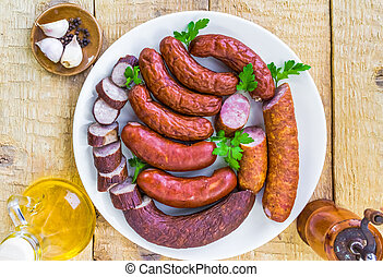plate full various species sausages - A plate full of...