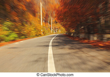 Autumn motion blurred road in Transylvania