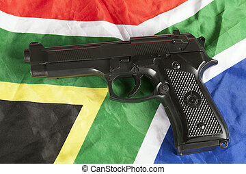Violent crime concept with handgun and South African flag